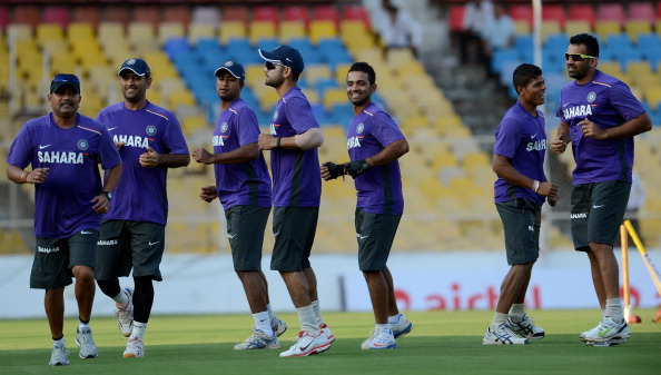Indian cricketers warm up during a training session at The Sardar Patel Stadium at Motera in Ahmedabad on November 12, 2012. India play the first Test match against England from November 15 in Ahmedabad. AFP PHOTO/ PUNIT PARANJPE        (Photo credit should read PUNIT PARANJPE/AFP/Getty Images)